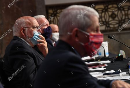 CDC Director Dr. Robert Redfield wears a face mask while testifying before the US Senate Health, Education, Labor and Pensions (HELP) Committee on Capitol Hill in Washington DC. Fauci and other government health officials updated the Senate on how to safely get back to school and the workplace during the COVID-19 pandemic.