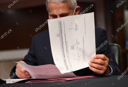 Dr. Anthony Fauci, director of the National Institute for Allergy and Infectious Diseases, prepares to testify before the Senate Health, Education, Labor and Pensions (HELP) Committee on Capitol Hill in Washington DC. Fauci and other government health officials updated the Senate on how to safely get back to school and the workplace during the COVID-19 pandemic.