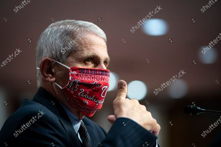 Anthony Fauci, director of the National Institute of Allergy and Infectious Diseases, gives a thumbs up during a Senate Health, Education, Labor and Pensions Committee hearing in Washington, D.C., U.S.,. Top federal health officials are expected to discuss efforts to get back to work and school during the coronavirus pandemic.