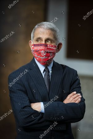 Anthony Fauci, director of the National Institute of Allergy and Infectious Diseases, wears a Washington Nationals protective mask while arriving to a Senate Health, Education, Labor and Pensions Committee hearing in Washington, D.C., U.S.,. Top federal health officials are expected to discuss efforts to get back to work and school during the coronavirus pandemic.
