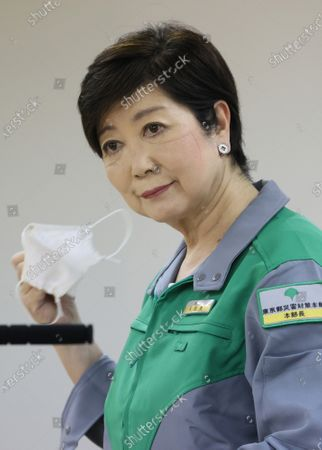 Tokyo Governor Yuriko Koike removes a face mask as she speaks before press at the Tokyo Metropolitan government office in Tokyo on Tuesday, June 30, 2020. Koike announced the new monitoring guideline on Toky's situation of the outbreak of the new coronavirus.
