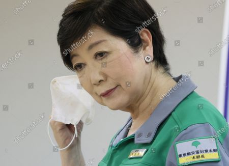 Tokyo Governor Yuriko Koike removes her face mask as she speaks before press at the Tokyo Metropolitan government office in Tokyo on Tuesday, June 30, 2020. Koike announced the new monitoring guideline on Toky's situation of the outbreak of the new coronavirus.