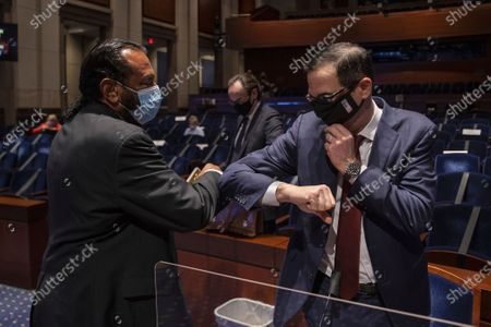 Rep. Al Green, D- Texas, left, and Treasury Secretary Stephen Mnuchin, bump elbows at the conclusion of a House Committee on Financial Services hearing on oversight of the Treasury Department and Federal Reserve pandemic response, on Capitol Hill in Washington