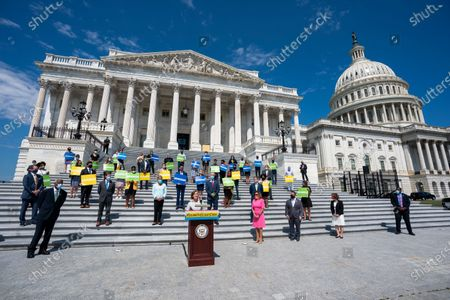 Democratic lawmaker from Florida Kathy Castor (C), along with Speaker of the House Nancy Pelosi and members of the Select Committee on the Climate Crisis, unveils a congressional action plan on the climate crisis outside the US Capitol in Washington, DC, USA, 30 June 2020.