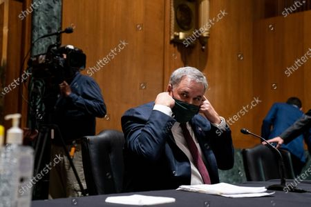 Stock Image of United States Senator Richard Burr (Republican of North Carolina) arrives to his seat ahead of a Senate Finance Committee hearing about the 2020 Filing Season and IRS COVID-19 Recovery at the U.S. Capitol in Washington DC.