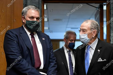 Internal Revenue Service Commissioner Charles Rettig, left, arrives with United States Senator Chuck Grassley (Republican of Iowa), Chairman, US Senate Committee on Finance, right, for a Senate Finance Committee hearing on Capitol Hill in Washington,, on the 2020 filing season and COVID-19 recovery.