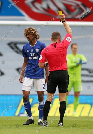Dion Sanderson of Cardiff City is given a yellow card by referee Steve Martin.