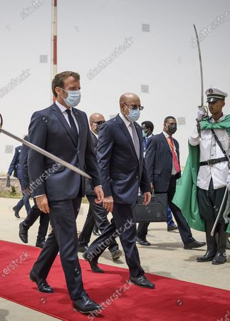 French President Emmanuel Macron arrives at Nouakchott Airport and is welcoming by Mauritanian President Mohamed Ould Ghazouani in Nouakchott, Mauritania