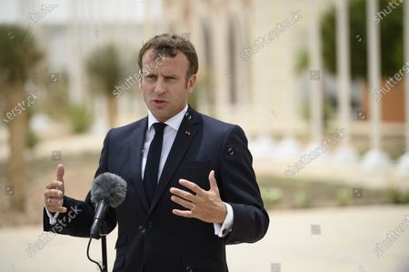 French President Emmanuel Macron arrives at Nouakchott Airport and speaks to the press in Nouakchott, Mauritania,