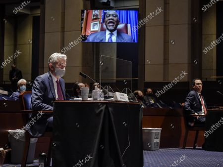 Stock Photo of Fed Chair Jerome Powell, left, and Treasury Secretary Stephen Mnuchin, right, listen to Rep. Gregory Meeks(D-NY), on a zoom screen, top, during the House Committee on Financial Services hearing on Oversight of the Treasury Department and Fed Reserve Pandemic response in Washington, DC, USA, 30 June 2020.