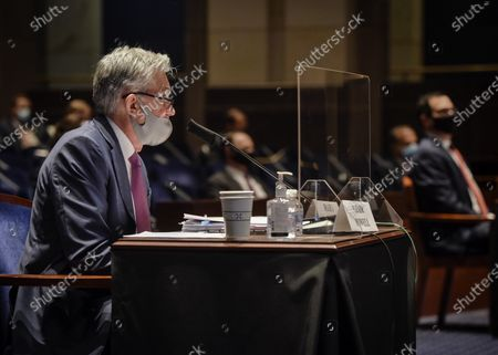 Fed Chairman Jerome Powell, left, and Treasury Secretary Stephen Mnuchin, right, appear before the House Committee on Financial Services hearing on Oversight of the Treasury Department and Fed Reserve Pandemic response in Washington, DC, USA, 30 June 2020.