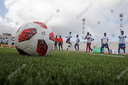 Football players warm up during the reopening of the stadium in Mogadishu, Somalia . At least three mortar blasts struck the Mogadishu Stadium Tuesday evening, just hours after it was reopened by Somalia's President Mohamed Abdullahi Mohamed, who had left before the shells hit, following years of instability
