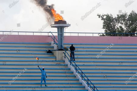 Ceremonial torch is lit to mark the reopening of the stadium in Mogadishu, Somalia . At least three mortar blasts struck the Mogadishu Stadium Tuesday evening, just hours after it was reopened by Somalia's President Mohamed Abdullahi Mohamed, who had left before the shells hit, following years of instability