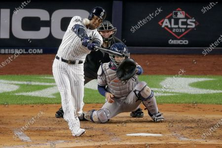 New York Yankees' Aaron Hicks connects for a three-run home run against the Houston Astros during the first inning of Game 5 of baseball's American League Championship Series, in New York. Yankees general manager Brian Cashman is optimistic Aaron Judge, James Paxton, Aaron Hicks and Giancarlo Stanton will be ready to play in time for New York's rescheduled opener at World Series champion Washington on July 23
