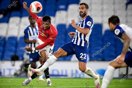 Manchester United's Marcus Rashford (L) in action against Brighton's Martin Montoya (R) in action during the English Premier League match between Brighton & Hove Albion and Manchester United in Brighton, Britain, 30 June 2020.