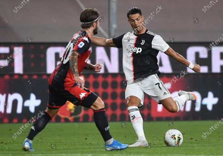 Genoa's Lasse Schone (L) in action against Cristiano Ronaldo (R) of Juventus during the Italian Serie A match between Genoa CFC and Juventus FC at Luigi Ferraris stadium in Genoa, Italy, 30 June 2020.