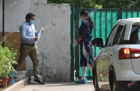 Enforcement Directorate (ED) officials arrive at Congress Rajya Sabha MP Ahmed Patel's residence in connection to a money laundering case involving Sandesara brothers on June 30, 2020 in New Delhi, India. A team of Enforcement Directorate once again arrived at the Delhi residence of senior Congress leader Ahmed Patel, a close aide of party interim Chief Sonia Gandhi, to question him in connection with the alleged multi-crore bank fraud case by the Gujarat-based Sterling Biotech.