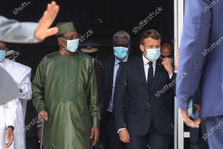 Chad President Idriss Deby, left, African Union Commission Moussa Faki, center, and France President Emmanuel Macron, right, arrive for a group picture during the G5 Sahel summit, in Nouakchott. Leaders from the five countries of West Africa's Sahel region, Burkina Faso, Chad, Mali, Mauritania and Niger, meet with French President Emmanuel Macron and Spanish Prime Minister Pedro Sanchez in Mauritania's capital Nouakchott on Tuesday to discuss military operations against Islamic extremists in the region, as jihadist attacks mount. The five African countries, known as the G5, have formed a joint military force that is working with France, which has thousands of troops to battle the extremists in the Sahel, the region south of the Sahara Desert