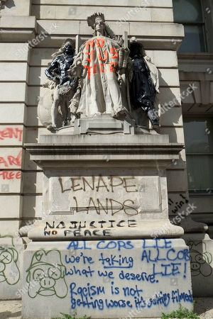 """The Surrogate Court building across from the """"Occupy City Hall"""" movement vandalized with anti-police graffiti."""