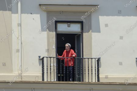 Stock Image of Emilio Fede out to the sixth floor balcony in the Grand Hotel Santa Lucia after being arrested for escaping while he was having dinner with his wife Diana De Feo, in a restaurant on the seafront of via Partenope in Naples.