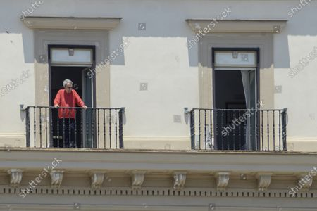 Stock Picture of Emilio Fede out to the sixth floor balcony in the Grand Hotel Santa Lucia after being arrested for escaping while he was having dinner with his wife Diana De Feo, in a restaurant on the seafront of via Partenope in Naples.