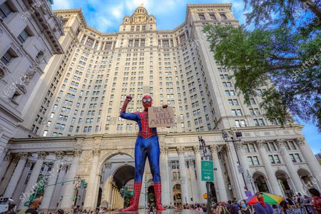 """Man in spiderman costume as the Black Lives Matter protesters' action continues to meet at City Hall as part of the """"Defund NYPD"""" and """"Occupy City Hall"""" movement in New York, United States"""