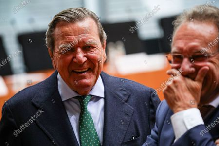 Stock Image of The Bundestag's Economic and Energy Committee Chairman Klaus Ernst (Die Linke) (R) and Former German Chancellor Gerhard Schroeder (L), prior to a hearing on the 'Nord Stream 2' Baltic gas pipeline at the Bundestag in Berlin, Germany, 01 July 2020. The Bundestag's Economic and Energy Committee holds a public hearing meant to ensure the sovereignty of German and European energy policy decisions. The 'Nord Stream 2' describes the second gas pipeline, currently under construction, consisting of two tubes, from Russia through the Baltic Sea to Lubmin in the German federal state of Mecklenburg-Western Pomerania.