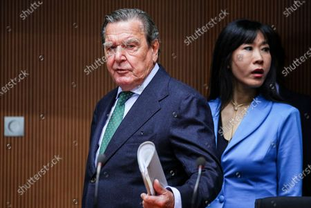 Former German Chancellor Gerhard Schroeder (L) and his wife Kim So-yeon (R) prior to a hearing on the 'Nord Stream 2' Baltic gas pipeline at the Bundestag in Berlin, Germany, 01 July 2020. The Bundestag's Economic and Energy Committee holds a public hearing meant to ensure the sovereignty of German and European energy policy decisions. The 'Nord Stream 2' describes the second gas pipeline, currently under construction, consisting of two tubes, from Russia through the Baltic Sea to Lubmin in the German federal state of Mecklenburg-Western Pomerania.