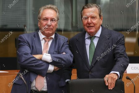 The Bundestag's Economic and Energy Committee Chairman Klaus Ernst (Die Linke) (L) and Former German Chancellor Gerhard Schroeder (R), prior to a hearing on the 'Nord Stream 2' Baltic gas pipeline at the Bundestag in Berlin, Germany, 01 July 2020. The Bundestag's Economic and Energy Committee holds a public hearing meant to ensure the sovereignty of German and European energy policy decisions. The 'Nord Stream 2' describes the second gas pipeline, currently under construction, consisting of two tubes, from Russia through the Baltic Sea to Lubmin in the German federal state of Mecklenburg-Western Pomerania.