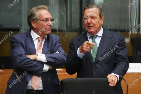 Stock Picture of The Bundestag's Economic and Energy Committee Chairman Klaus Ernst (Die Linke) (L) and Former German Chancellor Gerhard Schroeder (R), prior to a hearing on the 'Nord Stream 2' Baltic gas pipeline at the Bundestag in Berlin, Germany, 01 July 2020. The Bundestag's Economic and Energy Committee holds a public hearing meant to ensure the sovereignty of German and European energy policy decisions. The 'Nord Stream 2' describes the second gas pipeline, currently under construction, consisting of two tubes, from Russia through the Baltic Sea to Lubmin in the German federal state of Mecklenburg-Western Pomerania.