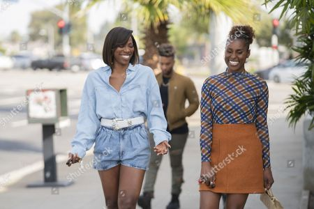 Yvonne Orji as Molly Carter and Issa Rae as Issa Dee
