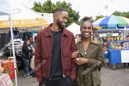 Jay Ellis as Lawrence Walker and Issa Rae as Issa Dee