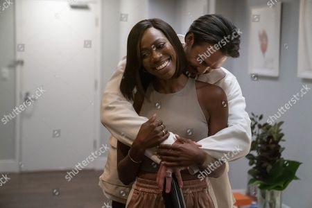 Yvonne Orji as Molly Carter and Alexander Hodge as Andrew Tan