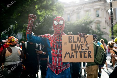 """A man dressed as Spiderman attends as protesters gather at the """"City Hall Autonomous Zone"""" in downtown Manhattan to bring attention to police brutality and systemic racism on June 30, 2020 in New York City. World wide protests broke after the Police killing of George Floyd in Minneapolis. Most protesters are wearing face masks to prevent the spread of COVID -19."""