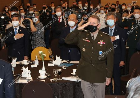Participants, including South Korean Defense Minister Jeong Kyeong-doo (L) and United States Forces Korea Commander Gen. Robert Abrams (R, front), salute their national flags at the 6th Korea-US alliance forum at the defense ministry's convention center in Seoul, South Korea, 01 July 2020.