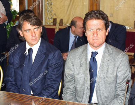 Lazio coach Roberto Mancini appears along side Roma manager Fabio Capello at a press conference prior to a Rome Derby match
