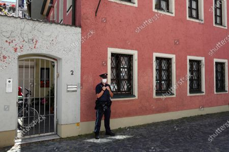 Police officer stands guard in front of the house of deceased cleric Georg Ratzinger in Regensburg, Germany, . The Rev. Georg Ratzinger, the older brother of Emeritus Pope Benedict XVI has died at age 96