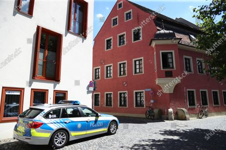 Police car stands guard in front of the house of deceased cleric Georg Ratzinger in Regensburg, Germany, . The Rev. Georg Ratzinger, the older brother of Emeritus Pope Benedict XVI has died at age 96