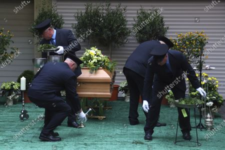 Pallbearers prepare the coffin of Georg Ratzinger in Regensburg, Germany, . The Rev. Georg Ratzinger, the older brother of Emeritus Pope Benedict XVI., has died at age 96