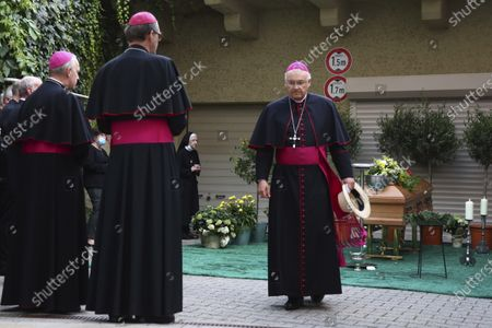 Rudolf Voderholzer, bishop of Regensburg, arrives at the coffin of Georg Ratzinger in Regensburg, Germany, . The Rev. Georg Ratzinger, the older brother of Emeritus Pope Benedict XVI., has died at age 96