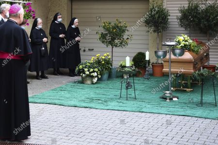 Nuns stand at the coffin of Georg Ratzinger in Regensburg, Germany, . The Rev. Georg Ratzinger, the older brother of Emeritus Pope Benedict XVI., has died at age 96