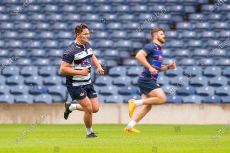(LtoR) Patrick Harrison and Luke Crosbie train in an empty stadium during the visual access training session for Edinburgh Rugby at BT Murrayfield Stadium, Edinburgh