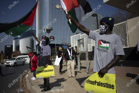 Protesters from the Ahmed Kathrada Foundation and '#africa4palestine' rally outside the United States Embassy in Johannesburg, South Africa, 01 July 2020. This follows Israel's plan to annex parts of the occupied West Bank, Gaza City.