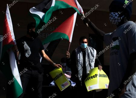 Stock Picture of Protesters from the Ahmed Kathrada Foundation and '#africa4palestine' rally outside the United States Embassy in Johannesburg, South Africa, 01 July 2020. This follows Israel's plan to annex parts of the occupied West Bank, Gaza City.