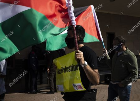 Stock Image of Protestors from the Ahmed Kathrada Foundation and #africa4palestine protest outside the United States Embassy , Johannesburg, South Africa, 01 July 2020. This follows Israel's plan to annex parts of the occupied West Bank, Gaza City.
