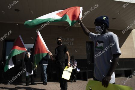 Stock Photo of Protestors from the Ahmed Kathrada Foundation and #africa4palestine protest outside the United States Embassy , Johannesburg, South Africa, 01 July 2020. This follows Israel's plan to annex parts of the occupied West Bank, Gaza City.