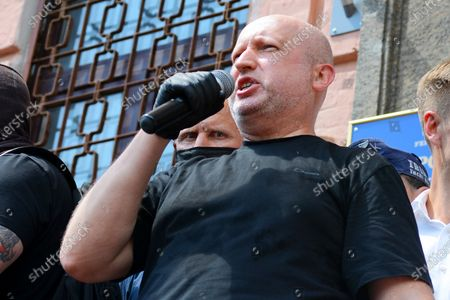 Stock Picture of KYIV, UKRAINE - 1 JULY 2020: Oleksandr Turchynov speaks into the microphone outside the Pechersk district court which will choose measures of restraint for Petro Poroshenko in the case of designation of Serhii Semochko to a post of Deputy Head of the Foreign Intelligence Service