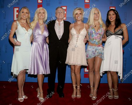 Hugh Hefner with Playmates arrive at E! Entertainment Television's Summer Splash Event at Amanda Scheer Demme's Tropicana Bar at the Roosevelt Hotel in Hollywood, CA