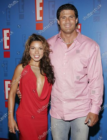 Jose Canseco and guest arrive at E! Entertainment Television's Summer Splash Event at Amanda Scheer Demme's Tropicana Bar at the Roosevelt Hotel in Hollywood, CA