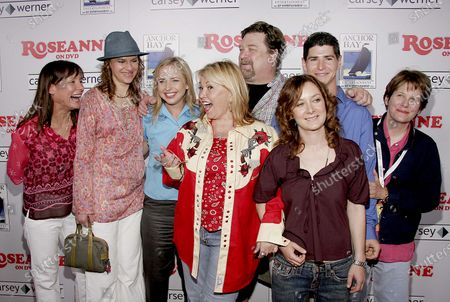 Stock Photo of Laurie Metcalf, Sandra Bernhard, Alicia Goranson, Roseanne, John Goodman, Michael Fishman, Sara Gilbert and Natalie West at the Roseanne Season One DVD launch party featuring the Original Cast of Roseanne at the Lucky Strike Bowling Center at Hollywood and Highland Complex in Hollywood, CA